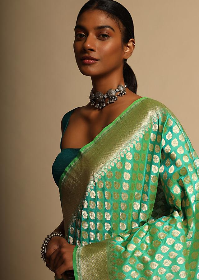Turquoise Green Two Toned Banarasi Saree In Pure Handloom Silk With Woven Floral Buttis And Chevron Border Along With Unstitched Blouse Piece Online - Kalki Fashion