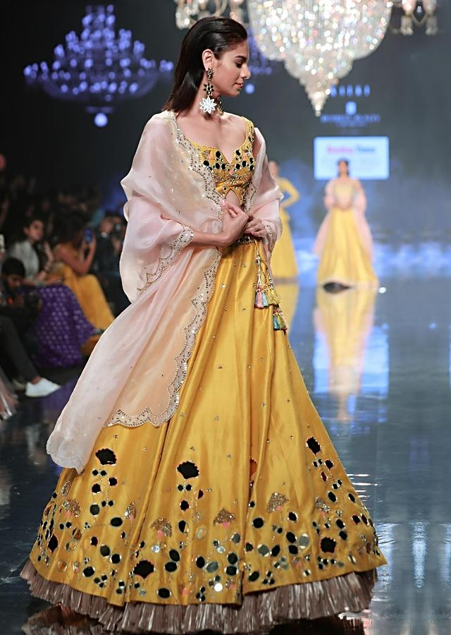 Sunset Yellow Lehenga Choli With Floral And Leaf Cut Mirror Work  Online - Kalki Fashion