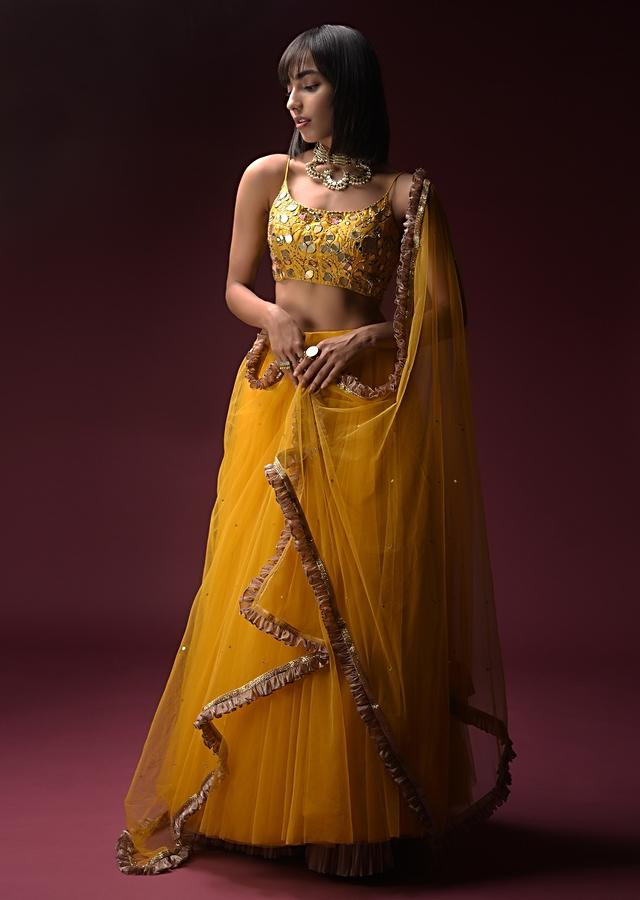 Tuscan Sun Yellow Skirt And Crop Top Set With Heavy Hand Embroidery Work Using Flower And Leaf Shaped Mirrors Online - Kalki Fashion