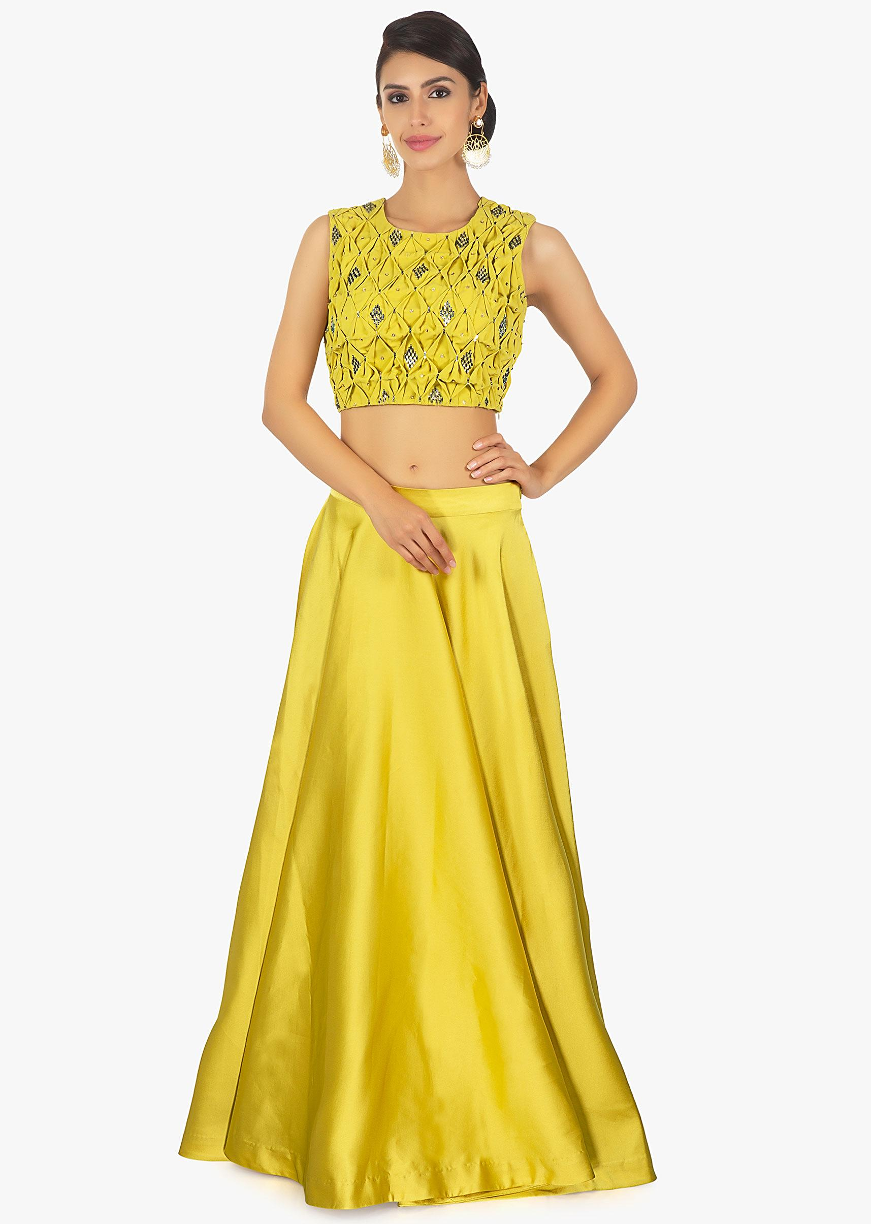 2cf96d869096a Tuscan yellow satin skirt paired with matching georgette smocked blouse only  on Kalki