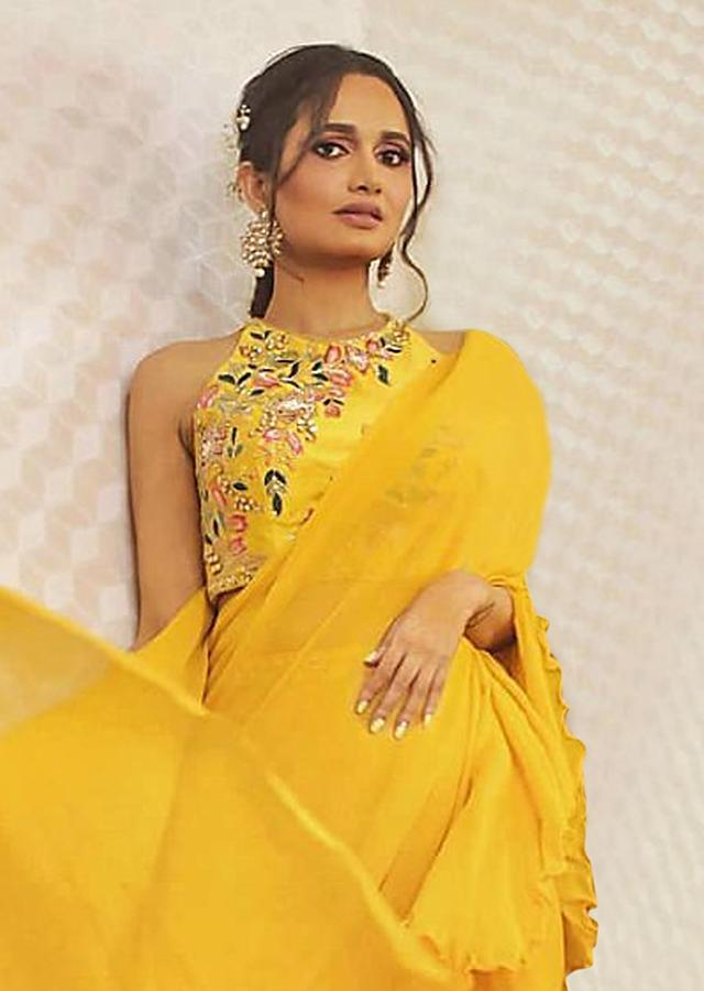 Tuscan Yellow Ruffle Saree With Floral Embroidered Crop Top Online - Kalki Fashion