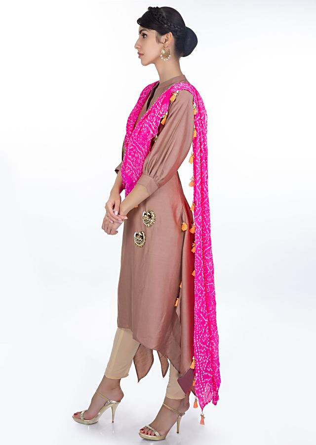 Tuscany brown kurti with a pre attached pink bandhani dupatta only on Kalki
