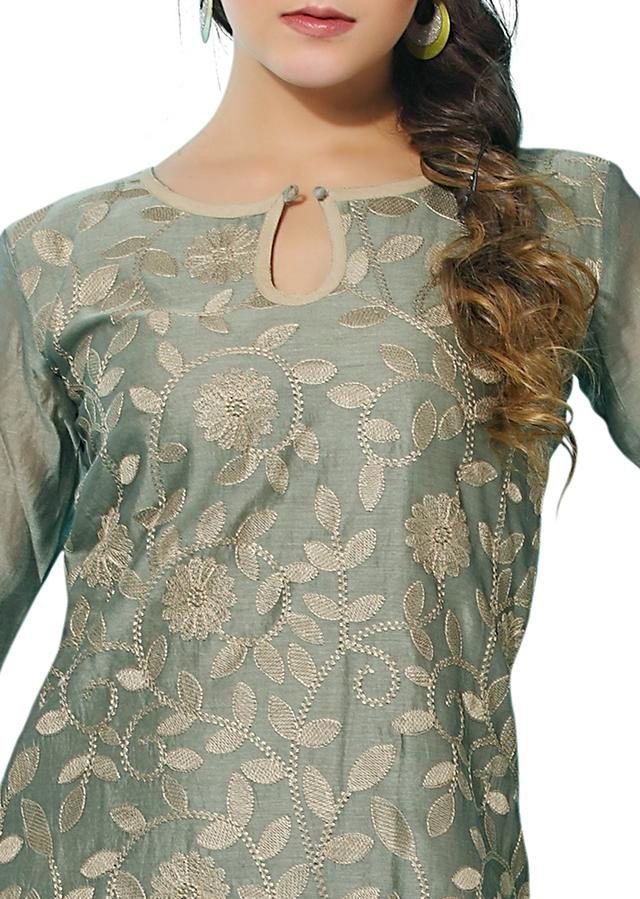 Unstitched suit embellished in  floral embroidery only on Kalki