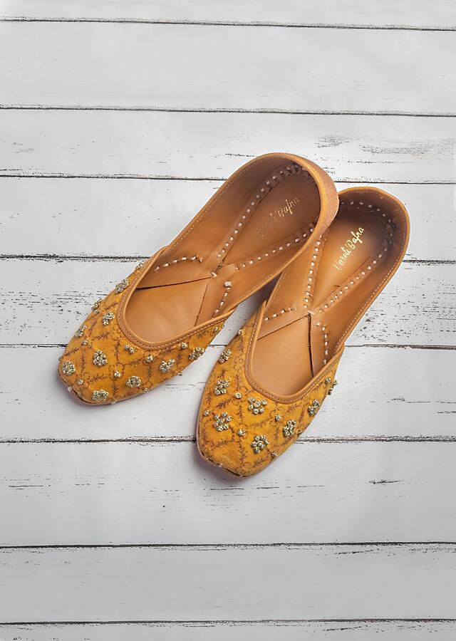 Mustard Yellow Juttis In Customized Moroccan Printed Linen With French Knot Embroidery By Vareli Bafna