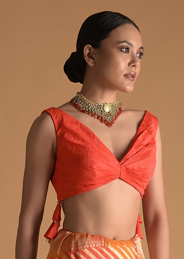 Vermillion Orange Blouse In Raw Silk With Pleat Details On The Front And Back Along With Tassels On The Sides Online - Kalki Fashion