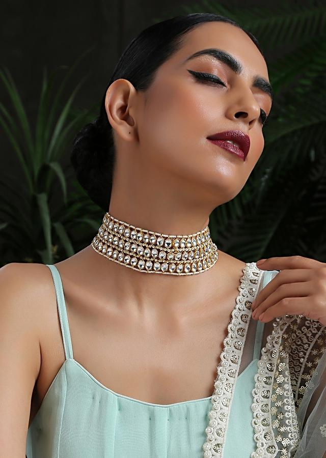 White And Gold Necklace With Four Rows Of Pearls Arranged In Symmetry Between Hexagon Shaped Kundan By Paisley Pop