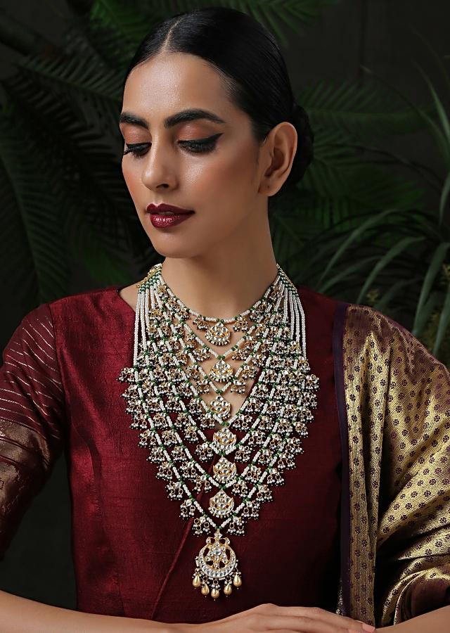White And Green Layered Necklace Featuring Beads, Shell Pearls And Kundan Along With A Pendant In The Centre Of Each Layer By Paisley Pop