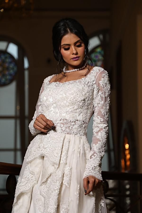 White Ballroom Gown With Centre Frills And Pleats Online - Kalki Fashion