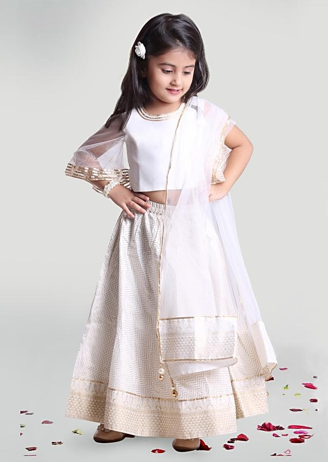 White Circular Skirt And Choli In Silk With Printed Chevron Design And Bell Sleeves By Mini Chic