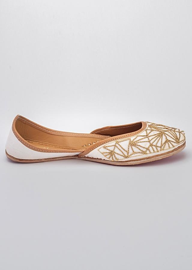 White Juttis In Raw Silk With Golden Dori Work In Jaal Design By Vareli Bafna