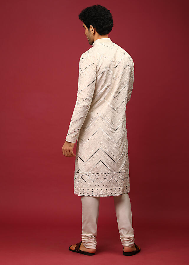 White Kurta Set In Raw Silk Heavily Embroidered With Resham And Mirror Embroidery In Floral And Chevron Design Online - Kalki Fashion