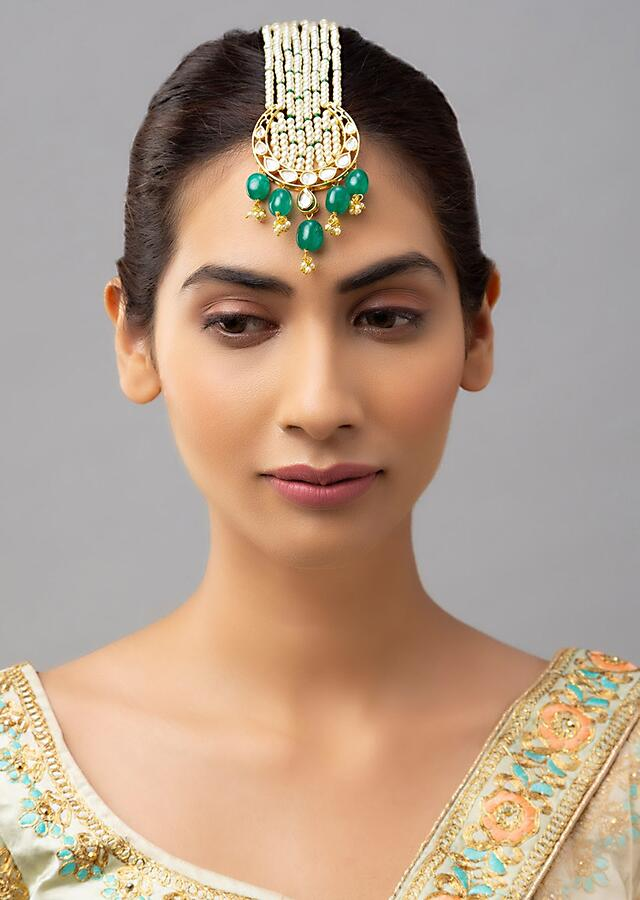 White Maang Tika With Shell Pearl Strings, Dangling Jades And Kundan Work In Crescent Motif Online - Joules By Radhika