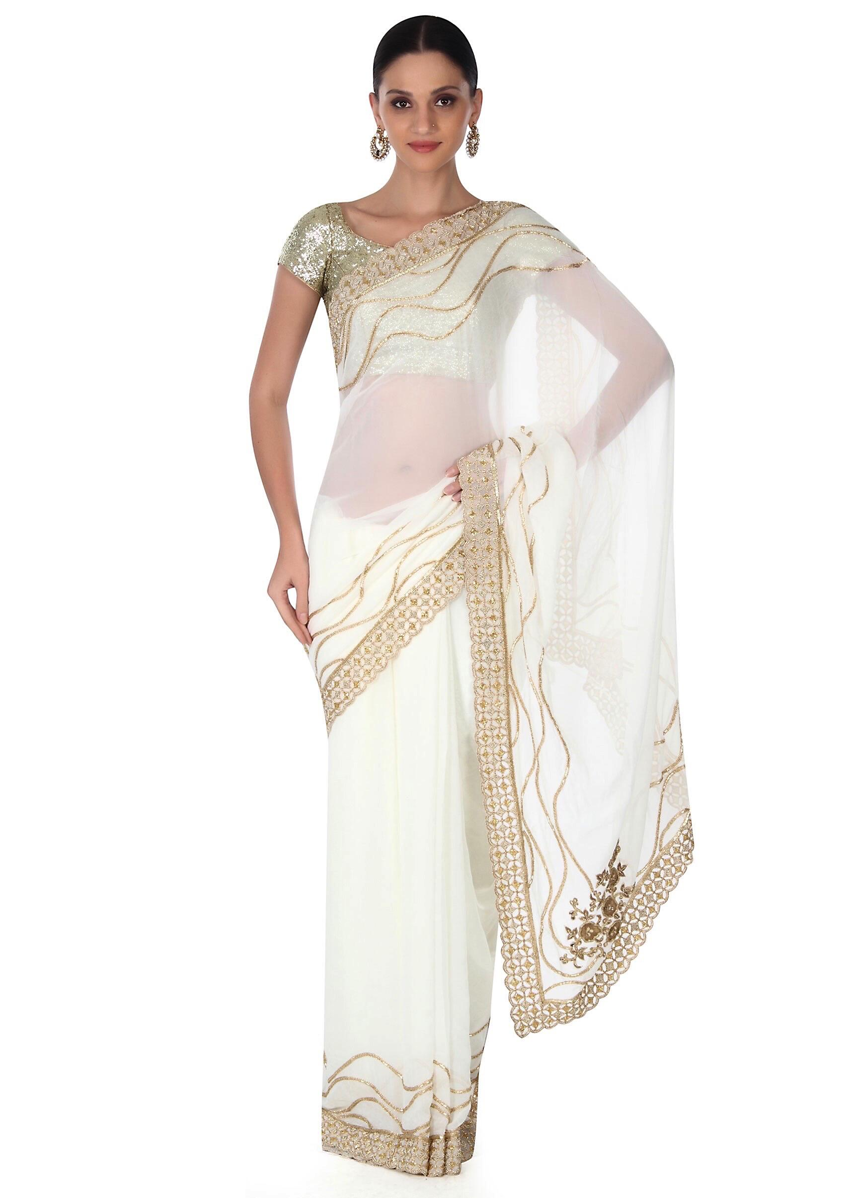 f9be5ed559 White saree adorn in gold embroidered border only on KalkiMore Detail