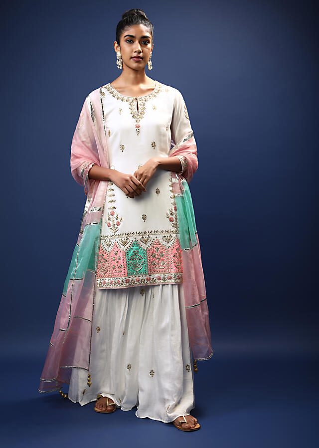 White Sharara Suit In Cotton With Gotta Patti Embroidered Buttis And A Multicolored Applique Work On The Border Online - Kalki Fashion