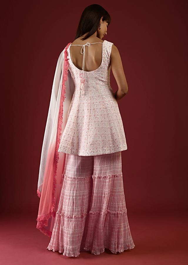 White Sharara Suit With A Peplum Kurti Adorned In Thread Embroidered Jaal Online - Kalki Fashion