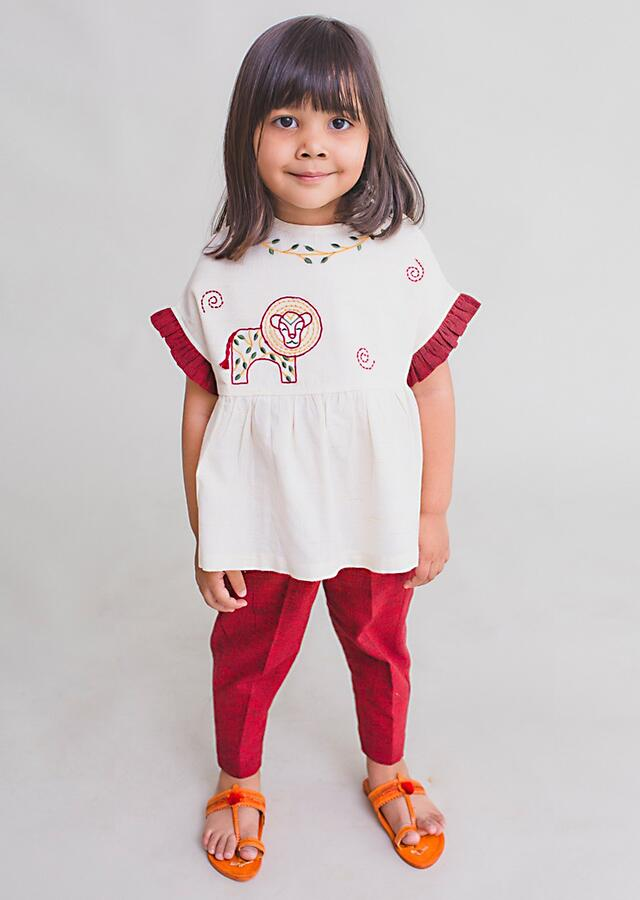 White Top And Burgundy Straight Cut Pants With Thread Embroidered Lion Motif By Tiber Taber
