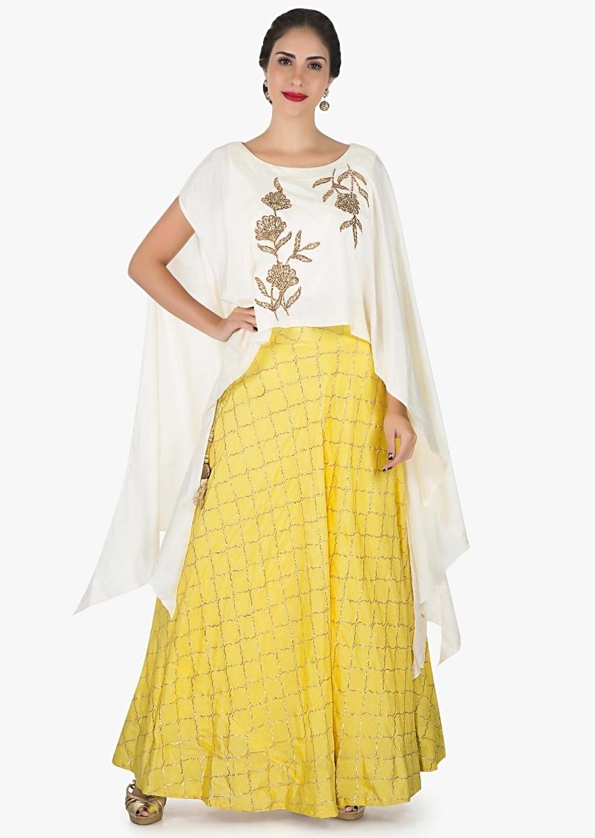 4568a96e98492 White and yellow skirt and top embellished in zari and zardosi embroidery  work only on Kalki