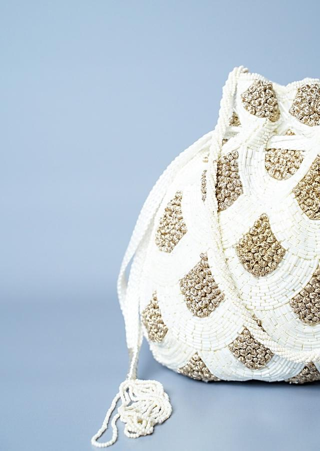 White Potli In Raw Silk With Japanese Bugle Beads Embroidered Scallop Design Online - Kalki Fashion