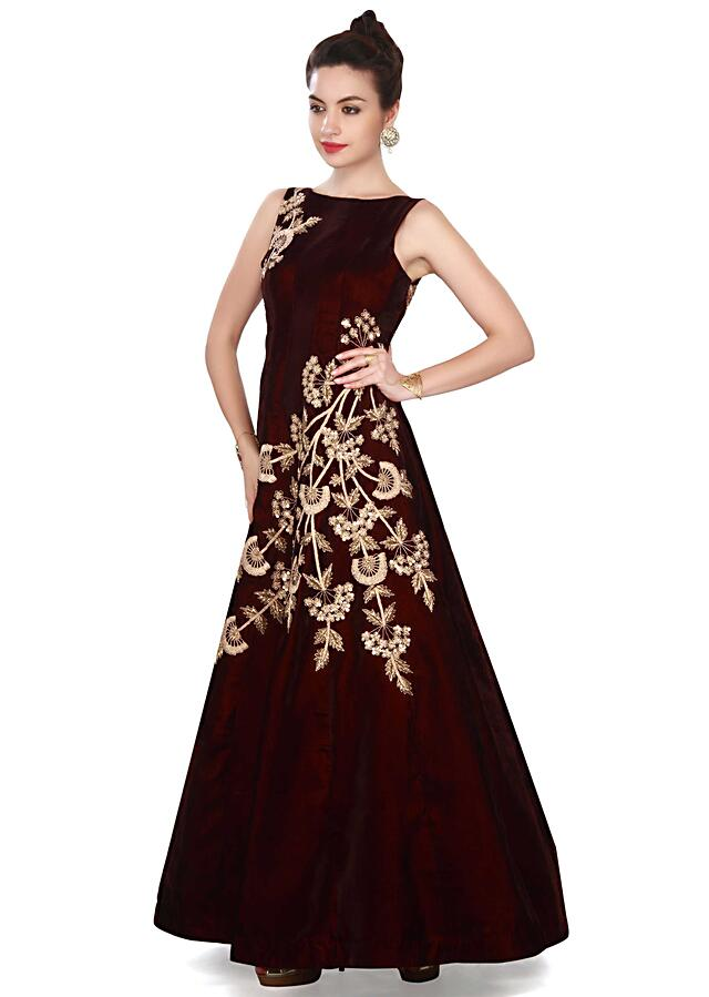 Wine gown adorn in zari and sequin in floral embroidery only on Kalki