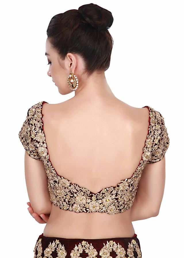 Wine lehenga adorn in zari and kundan embroidery all over only on Kalki