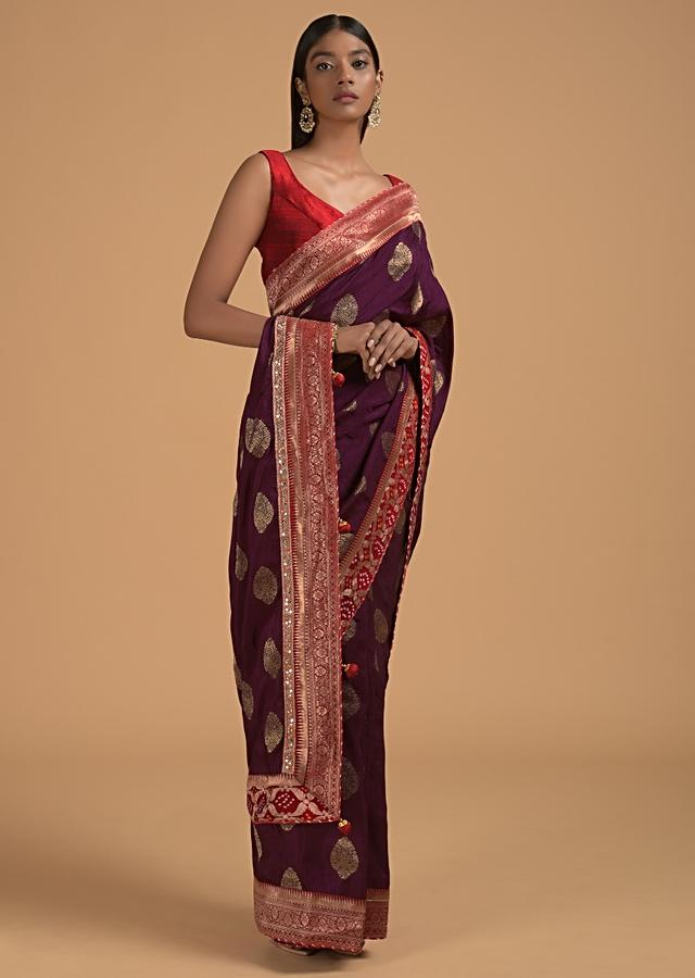 Wine Purple Saree In Dola Silk With Brocade Leaf Shaped Buttis And Contrast Red Bandhani Border Online - Kalki Fashion