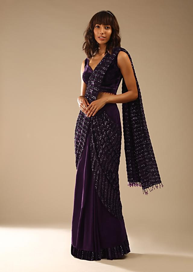 Wine Purple Ready Pleated Saree In Crepe With Striped Sequins Pallu And Matching Velvet Blouse With Bead Tassels Online - Kalki Fashion