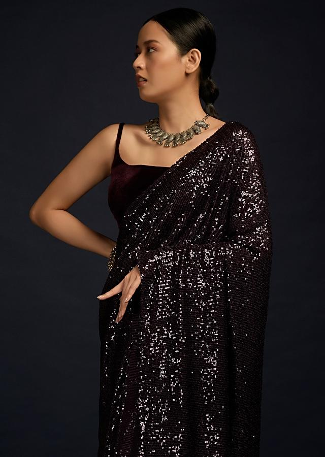 Wine Purple Ready Pleated Saree In Sequins Fabric And Matching Velvet Blouse With Straps On The Shoulder Online - Kalki Fashion