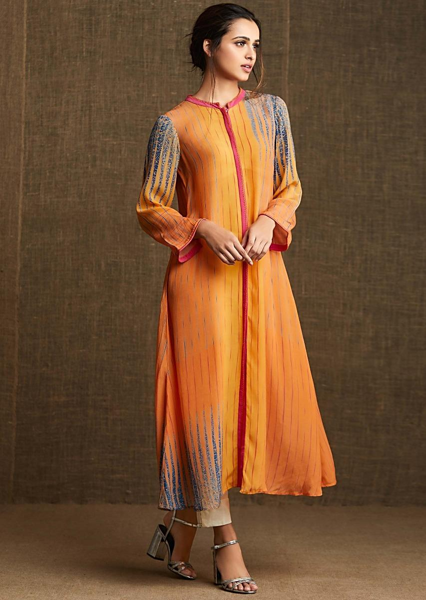 c316e2c88a19 Yellow and orange kurti in pure crepe with contrast pink collar and piping
