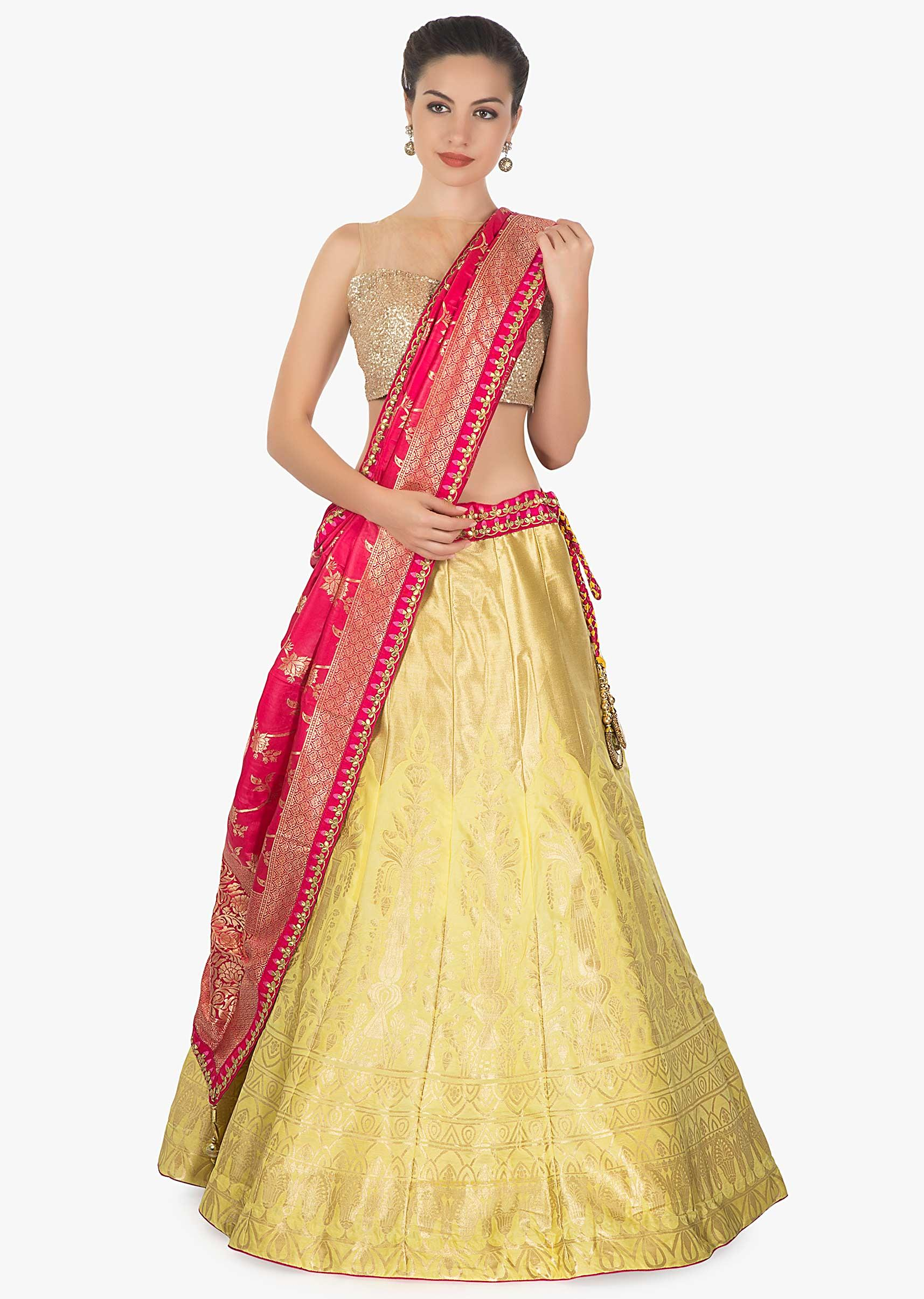 db0f1275f8 Yellow brocade silk lehenga featuring with rani pink brocade dupatta only  on kalkiMore Detail
