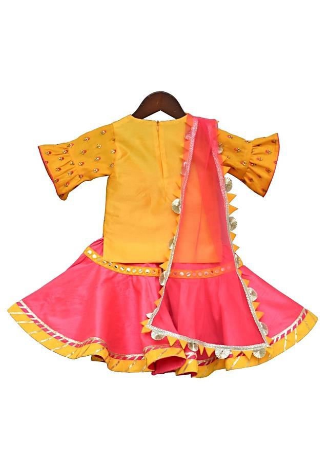 Yellow Kurti With Embroidery Work Teamed With Sharara And Net Dupatta by Fayon Kids