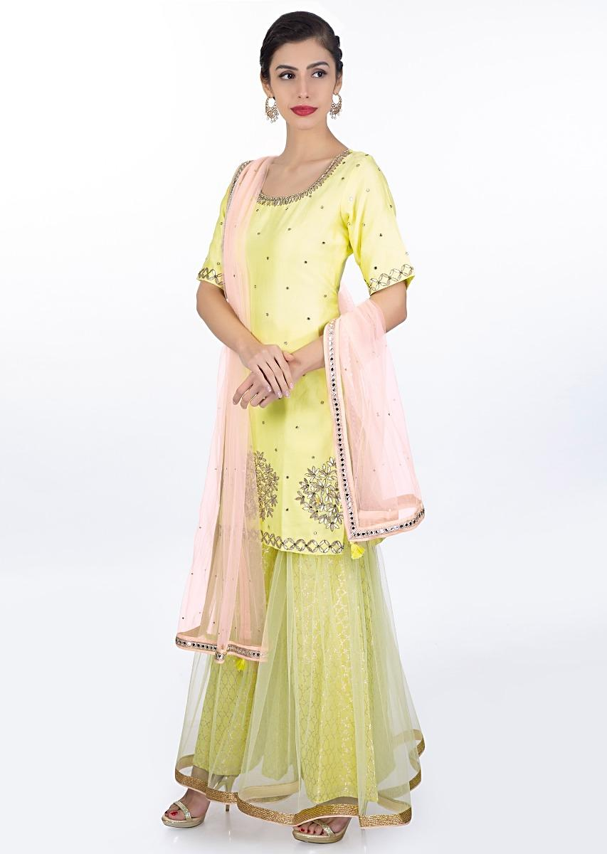 89e80e2f9f Yellow gotta patch embroidered suit with matching brocade sharara in net  lining and dark cream net dupatta only on KalkiMore Detail