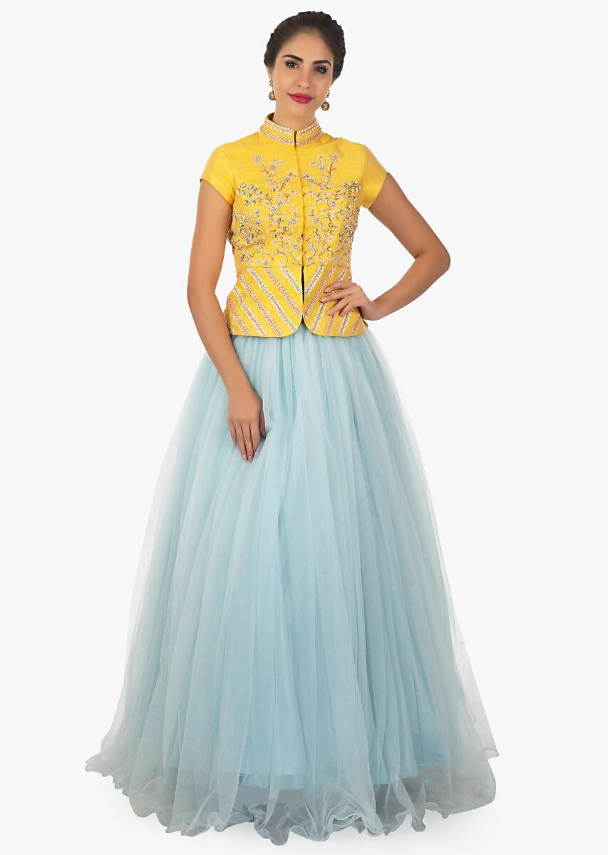 7d34a0274e97e Yellow peplum top paired with a sky blue lehenga and shaded dupatta only on  kalki