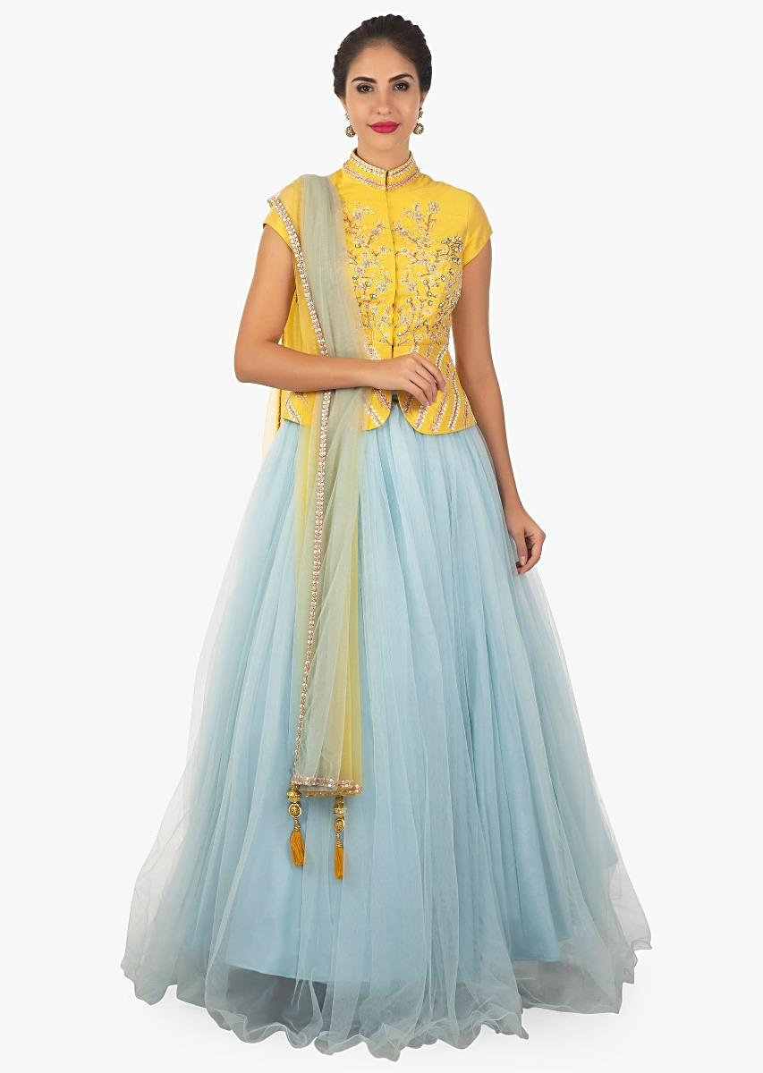58fce064e53f0 Yellow peplum top paired with a sky blue lehenga and shaded dupatta only on  kalki