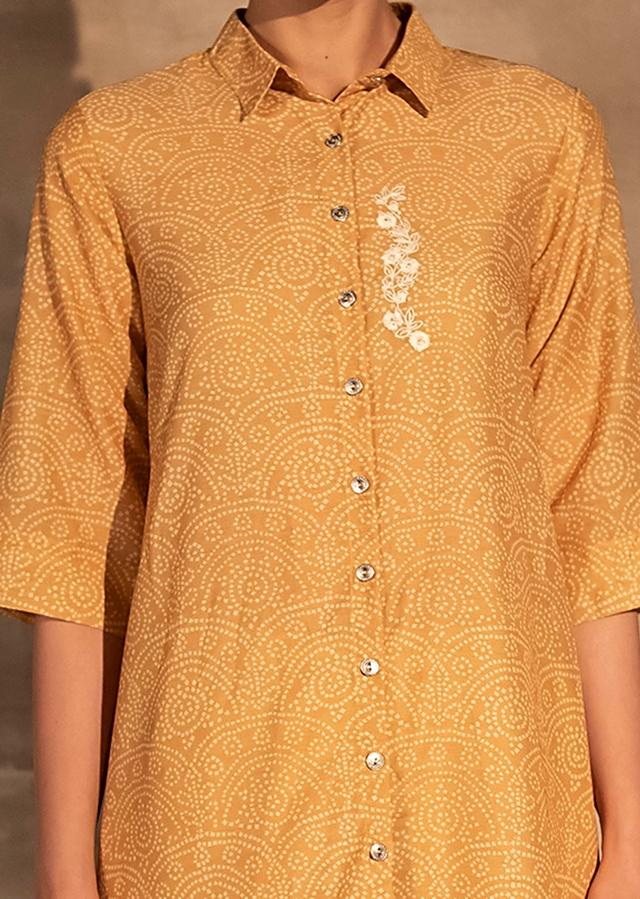 Yellow Pleated Tunic In Muslin With Bandhani Print And Aari Embroidered Patch Online - Kalki Fashion