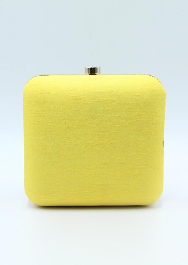 Yellow raw silk hand embroidered clutch only on Kalki
