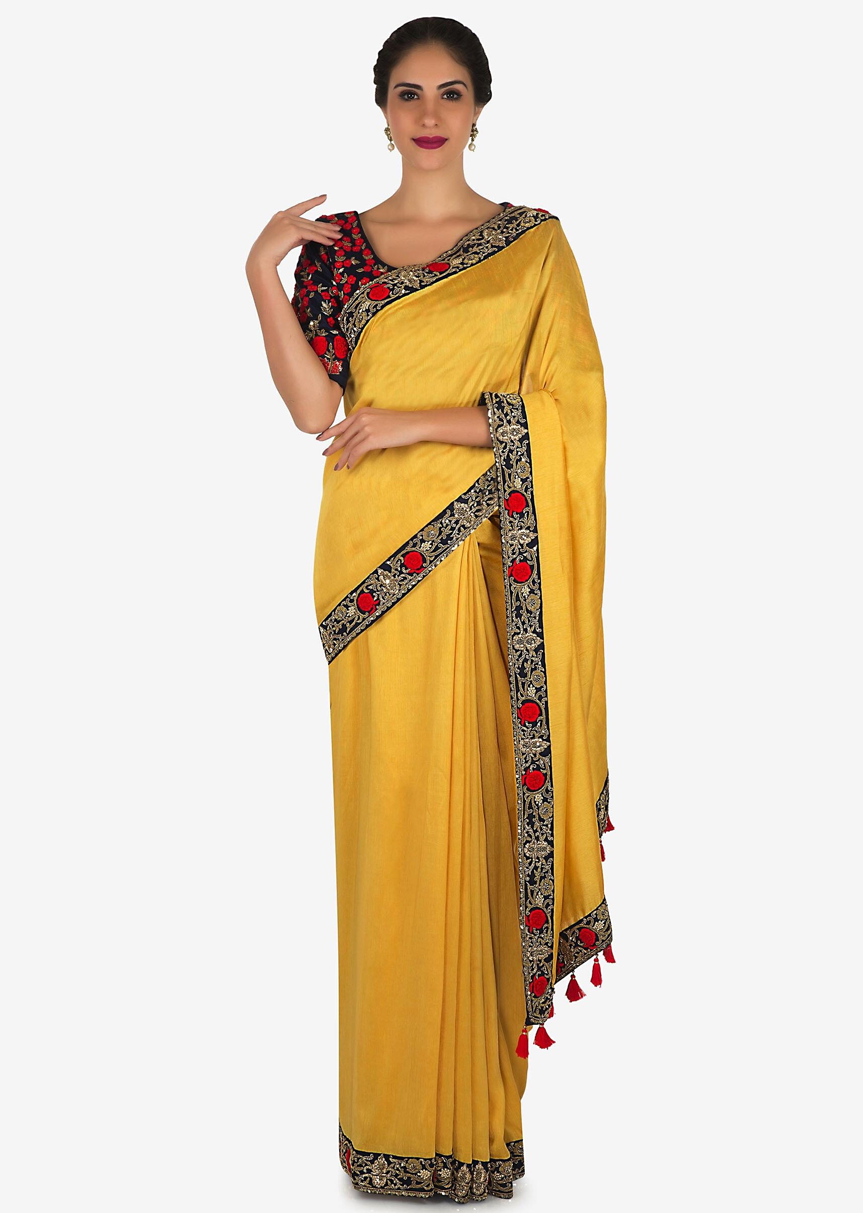 01c177cc511d0d Yellow saree in satin silk with a navy blue blouse embroidered with zardosi  and thread work only on KalkiMore Detail