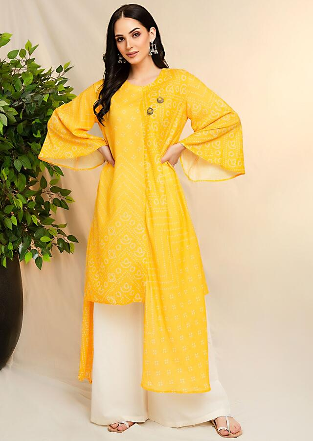 Yellow Tunic Set With Asymmetric Hemline, Bell Sleeves And Bandhani Print Online - Kalki Fashion