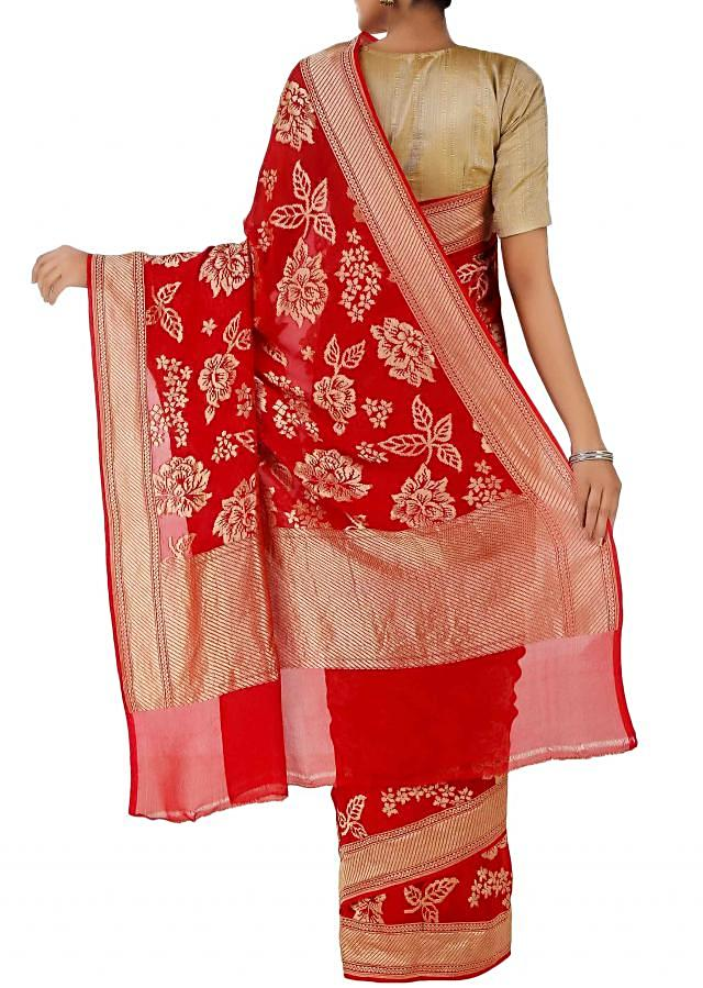 Red handloom saree with enlarged floral motifs and metallic border