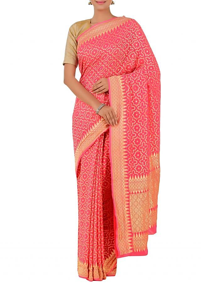 Pink handloom chiffon saree with geometric grid and metallic border