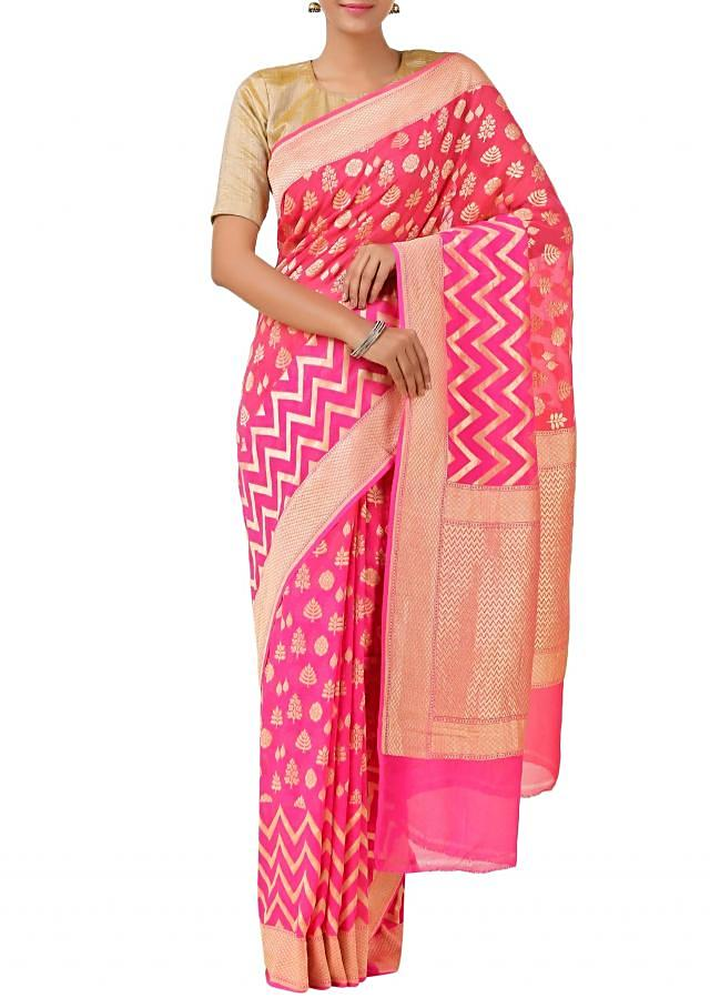 Pink handloom saree with floral motif and chevron pattern