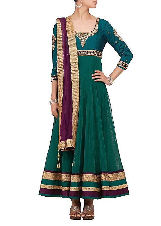 Anarkali in Teal net fabric with lirex and velvet border at the hem  by Kalki