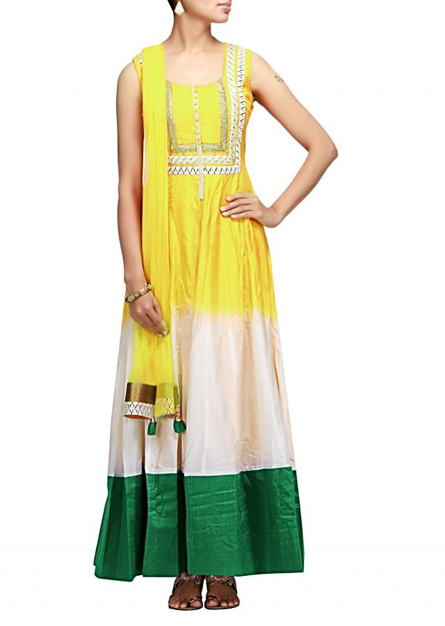 Shaded anarkali suit in white and yellow with embroidered neckline