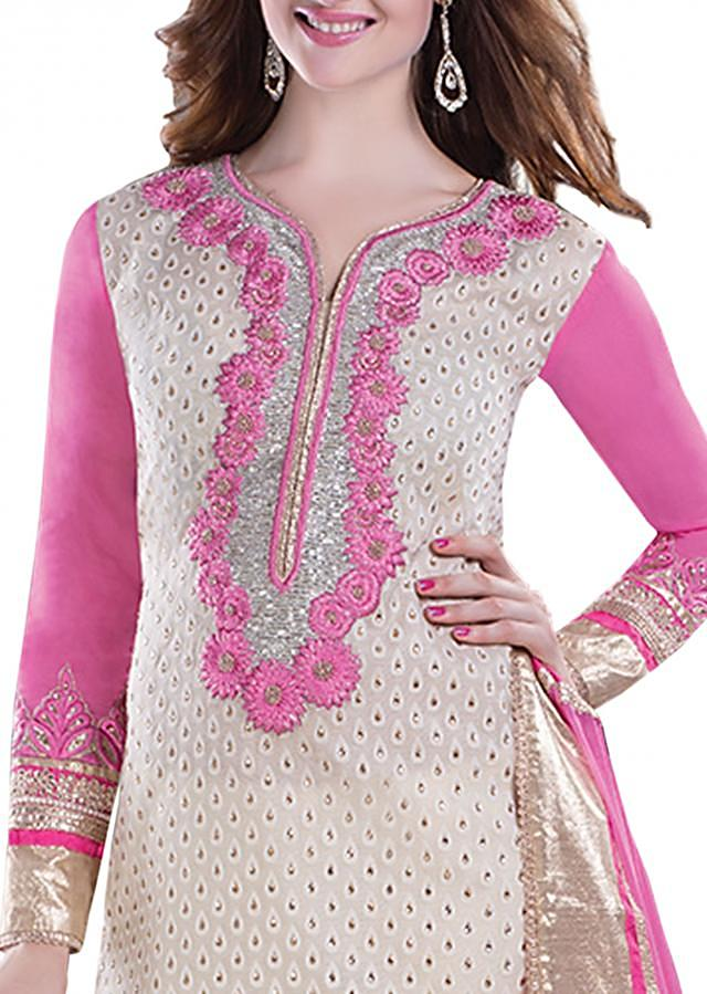 Semi stitched off white with pink suit featuring kundan work