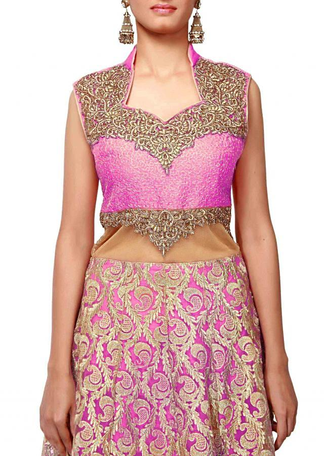 Gold and pink anarkali suit embellished in zari and kardana embroidery only on Kalki