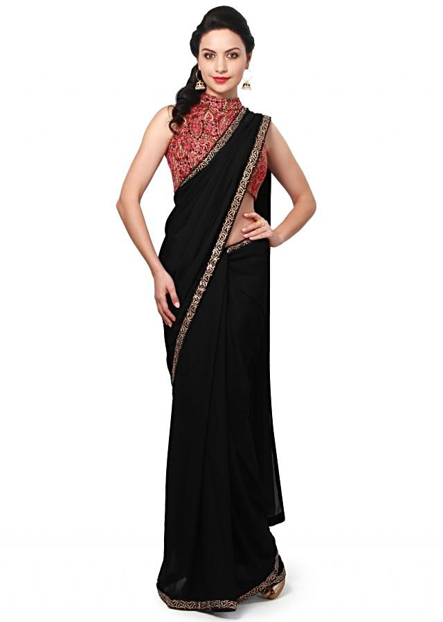Black saree features with embellished blouse only on Kalki