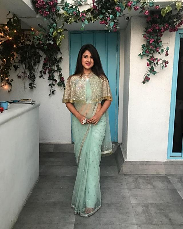 Mint Green Net Saree with Cape Net Blouse Featuring Sequins and Tassels only on Kalki