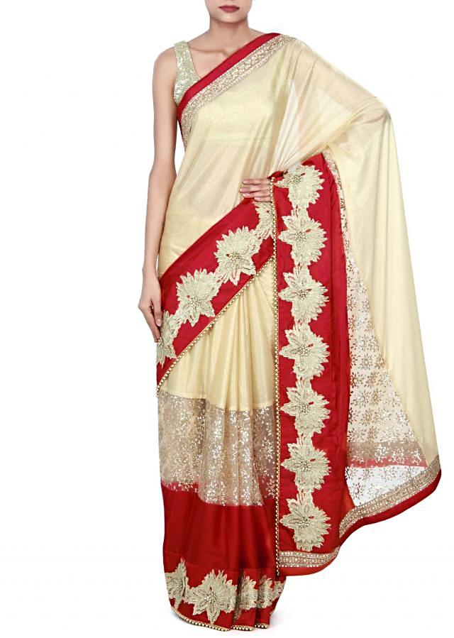 Beige saree adorn in cut work border only on Kalki