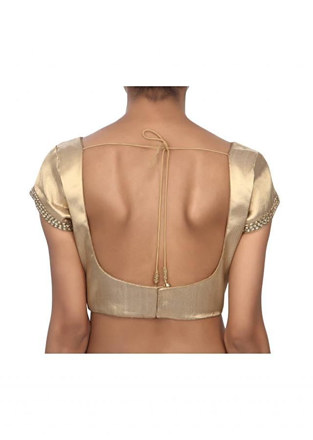Gold blouse enhanced in kundan embroidery only on Kalki