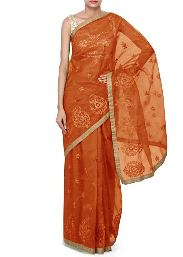 Rust saree enhanced in zari weave embroidery only on Kalki