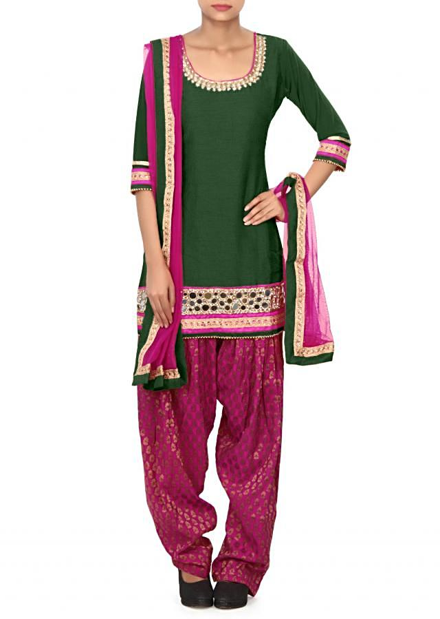 Bottle green patiala suit enhanced in mirror and zari embroidery only on Kalki